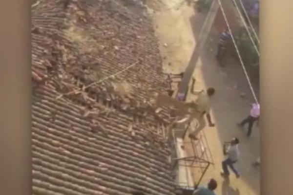 Indian-forest-ranger-jumps-off-house-roof-to-dodge-leopard-attack.jpg
