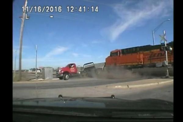 tow truck hit by train.jpg