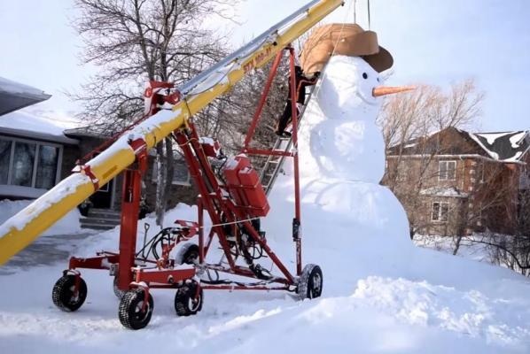 Canadian family builds tall snowman.jpg